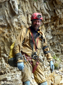Photograph of Graham Coates embarking on a caving trip