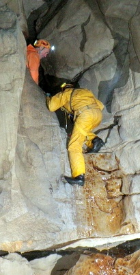 Photograph of Graham Coates working with clients in Lower Long Churn Cave