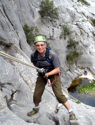 A client enjoying abseiling under Graham's instruction