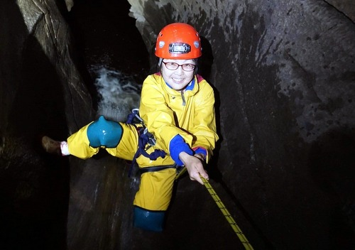 A happy client in Upper Long Churn Cave in the Dales